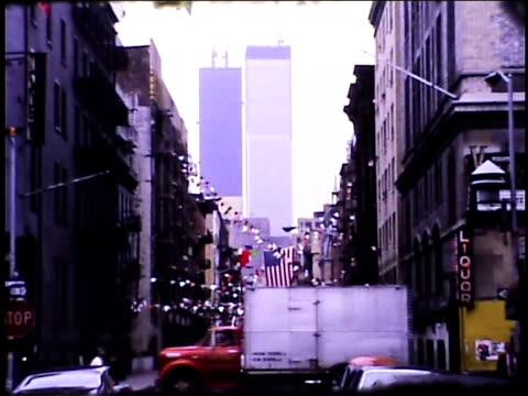 vídeos de stock e filmes b-roll de / view from thompson and bleeker street in soho of the world trade center building under construction on january 01, 1970 in new york, new york - world trade center manhattan