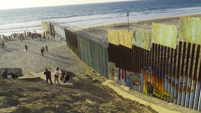stockvideo's en b-roll-footage met view from tijuana mexico of 'las playas de tijuana' overlooking 'friendship park' the us border patrol agents monitor from the us side and it is the... - san diego