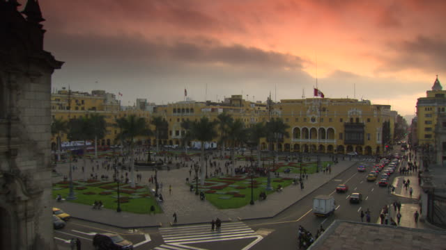 """view from top of building at corner of plaza mayor/plaza de la armas of lima towards the municipal palace of lima [municipalidad metropolitana de lima] and the palace of the union , peach and orange sky, lima, peru"" - lima peru stock videos and b-roll footage"