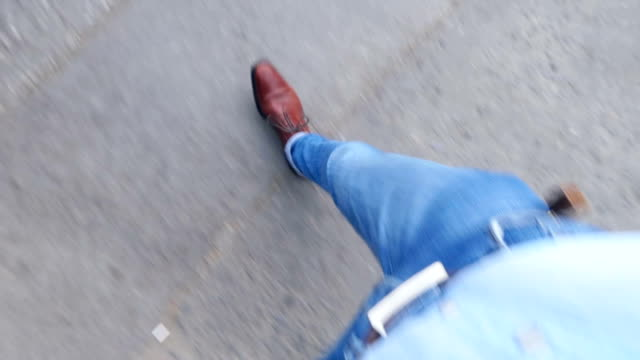 view from top to man's legs walking on sidewalk on street - sidewalk stock videos & royalty-free footage