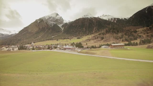 view from train of st. moritz switerland - zugperspektive stock-videos und b-roll-filmmaterial