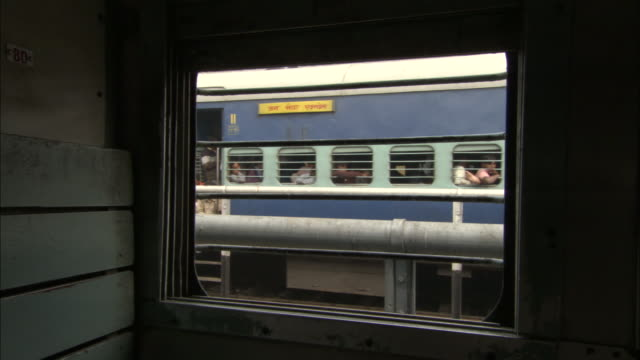 view from train window as train passes by, sonepur available in hd. - tour bus stock videos and b-roll footage