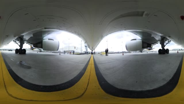 A view from under a jet airliner on the tarmac at Miami International Airport
