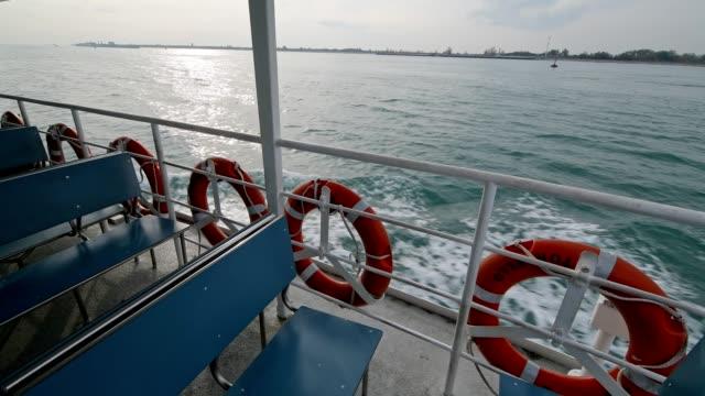 view from vaporetto at lagoon, venice, venetian lagoon, veneto, italy - traghetto video stock e b–roll