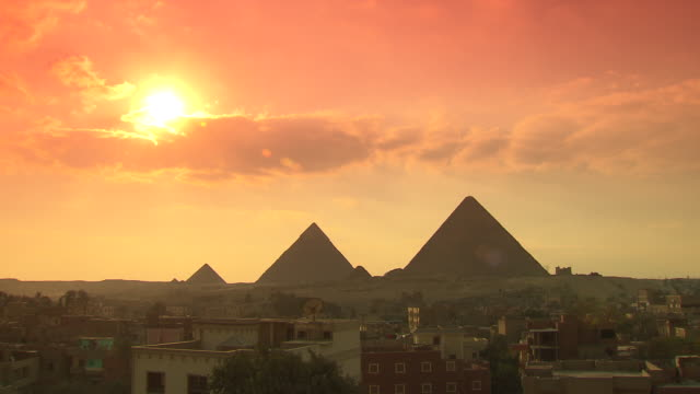 ws view giza pyramids at sunset / giza, egypt - pyramid stock videos and b-roll footage
