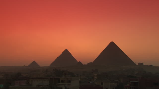 WS ZI View Giza pyramids at sunset / Giza, Egypt