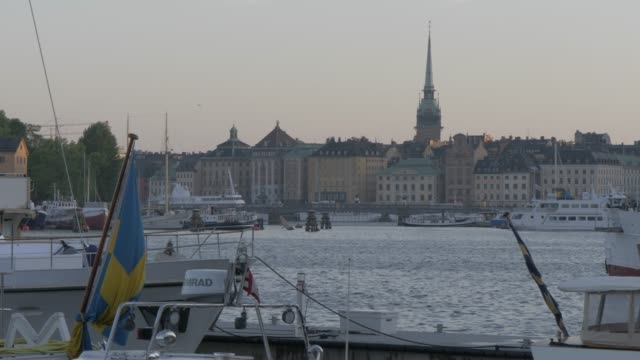 view harbour boats and gamla stan, stockholm, sweden, scandinavia, europe - swedish flag stock videos and b-roll footage