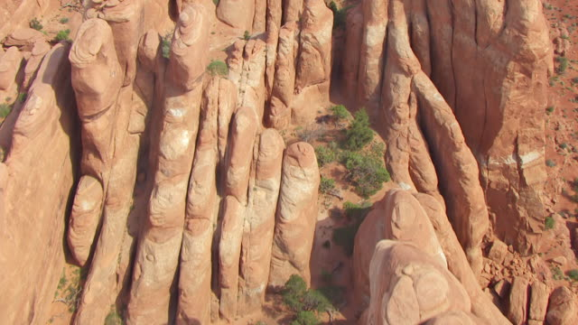 cu aerial view high flying over klondike bluffs at arches national park / utah, united states - klondike stock videos and b-roll footage