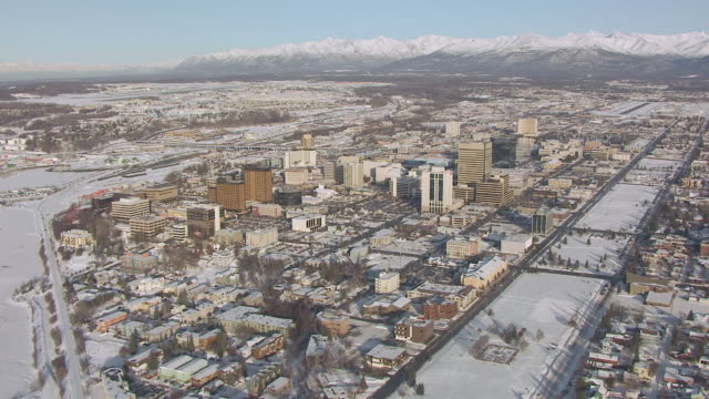 ws aerial view high over downtown and chugach mountains / anchorage, alaska, united states - anchorage alaska stock videos & royalty-free footage