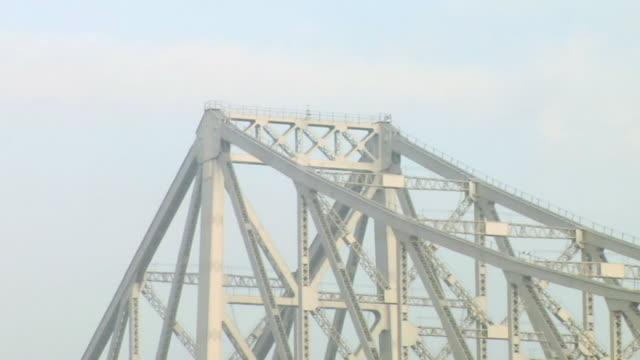cu zo view  howrah bridge over hooghly river  / kolkata, west bengal, india - howrah bridge stock videos & royalty-free footage