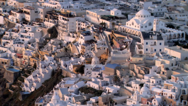 aerial ws ds view in sunset over thera, thira, santorini / santorini, thera, cyclades islands, greece - insel santorin stock-videos und b-roll-filmmaterial