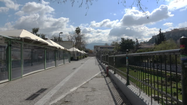 view in the empty street and closed shops due to the ban in thiseio area, located under the acropolis, that is one of the most touristic areas of the... - athens greece stock videos & royalty-free footage