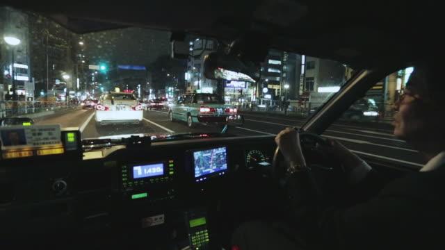 POV, WS View inside a taxi travelling through Tokyo's Shinjuku district at night / Tokyo, Japan