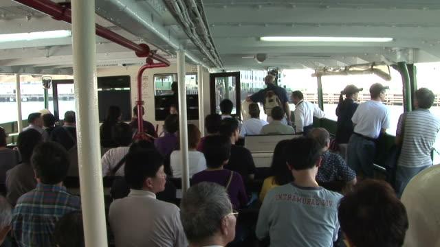 vídeos y material grabado en eventos de stock de view inside of a ferry in hong kong china - pasear en coche sin destino