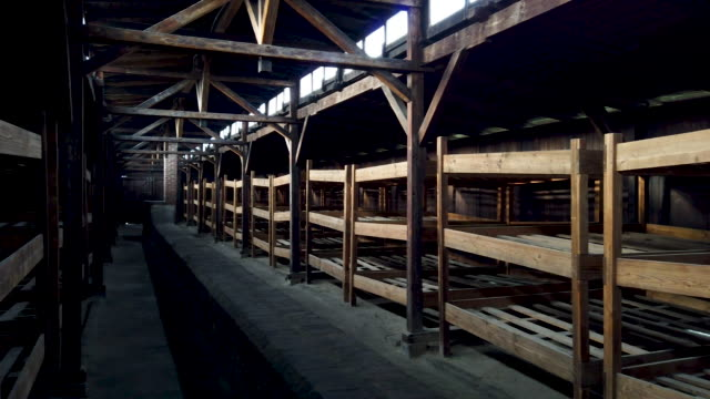 view inside one of the huts that housed up to 300 internees at auschwitz -birkeneau ii at extermination camp on december 19, 2019 in oswiecim,... - concentration camp stock videos & royalty-free footage