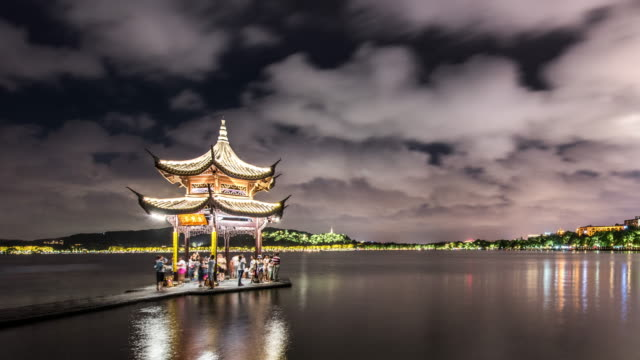 t/l ws view jixian pavilion of west lake in hangzhou at night / hangzhou, china - pavilion stock videos and b-roll footage