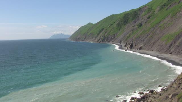 WS AERIAL View low along coastline / Kodiak Island, Alaska, United States