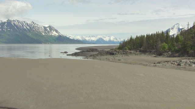 ws aerial view low along mudflats at turn again arm / alaska, united states - anchorage alaska stock videos & royalty-free footage