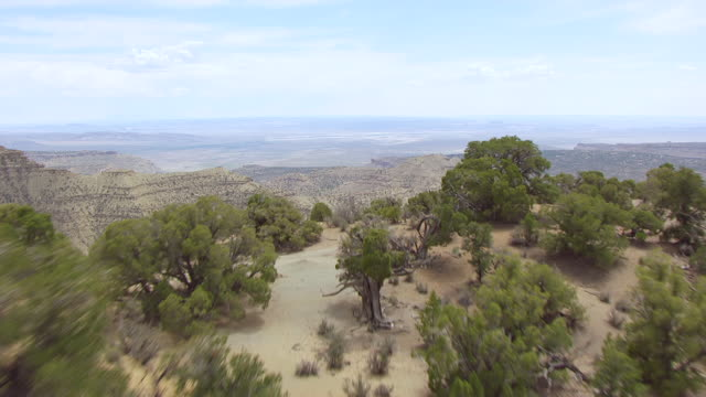ws aerial view low over hilly land to colorado plateau / utah, united states - colorado plateau stock videos & royalty-free footage