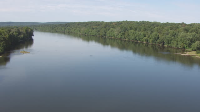 WS AERIAL View low over trees to Delaware river / New Jersey, United States