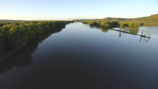 MS AERIAL View low over Upper Mississippi Fish and Wildlife Refuge with soft sunlight during sunset / Iowa, United States