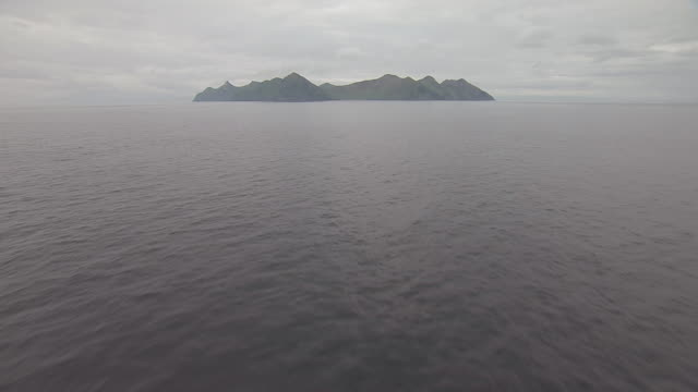WS AERIAL TU View low over water to Barren Islands / Alaska, United States