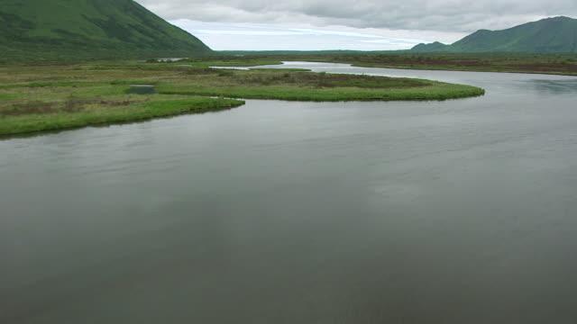 WS AERIAL View low over wide Karluk river / Kodiak Island, Alaska, United States