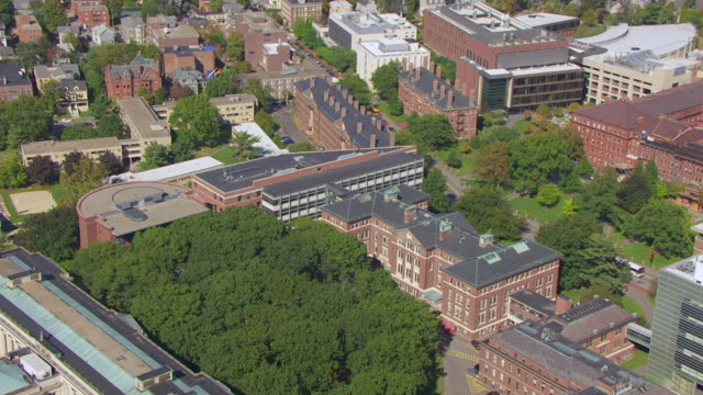 stockvideo's en b-roll-footage met ws aerial pov view maxwell dworkin laboratory and harvard university campus with city / cambridge, massachusetts, united states - harvard university