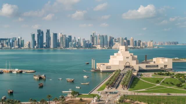 vídeos de stock e filmes b-roll de ws pov t/l view museum of islamic art and dhow harbour at night / doha, qatar - doha