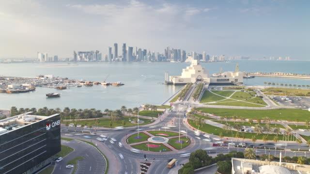vídeos de stock e filmes b-roll de ws pov t/l view  museum of islamic art and dhow harbour   / doha, qatar - doha