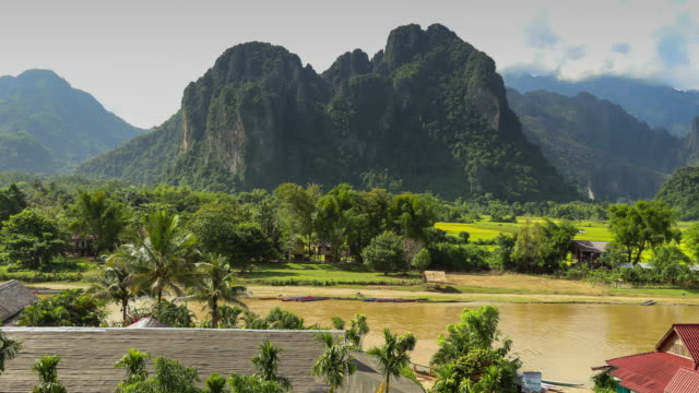 view nature at vang vieng in laos time lapse. - guerra del vietnam video stock e b–roll