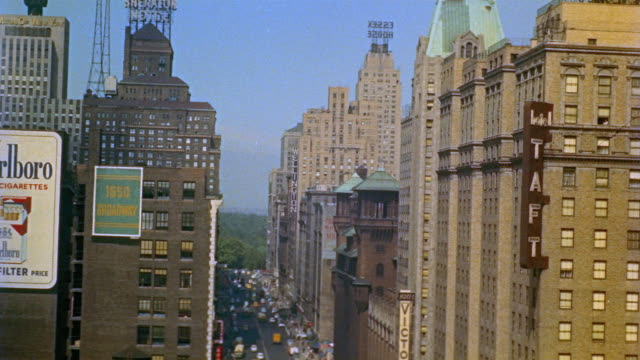 1955 montage ha view north up 7th avenue toward central park / ha midtown manhattan and the capitol theatre on broadway / new york city - 1955 stock videos & royalty-free footage
