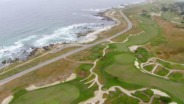 WS AERIAL View of 17 Mile Drive at Pebble Beach golf course / California, United States
