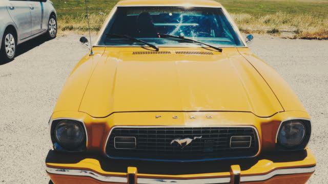 a view of 1974 ford mustang the mustang ii was named motor trend's car of the year in 1974 the last mustang to achieve that honor until 1994 - ford mustang stock videos and b-roll footage