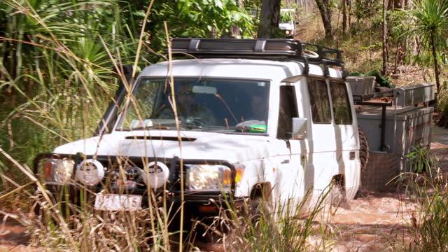 WS ZO View of 4WD moving through water / Darwin, Northern Territory, Australia