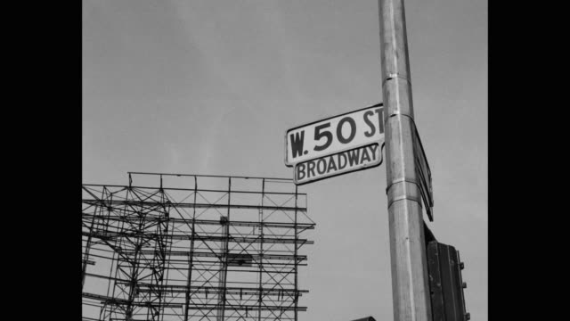 view of 50th street sign and billboard structure against sky, new york city, new york state, usa - new york city 1950s stock videos & royalty-free footage