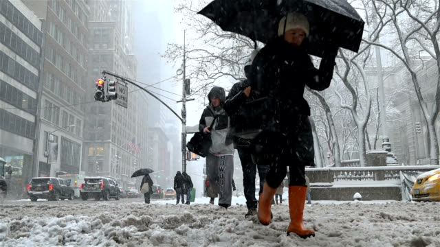 View of 5th Avnue and 42nd Street / Following a day of 60 degree Fahrenheit temperature winter storm Niko hits the Northeast of the United States /...