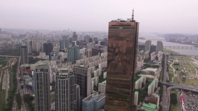 ws aerial view of 63 building and yeouido business district / seoul, south korea - 2013 stock videos & royalty-free footage