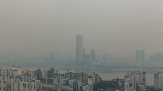 view of 63 buliding (the tallest building in 1990s, korea) and han river in fine dust, seoul - smog stock videos & royalty-free footage