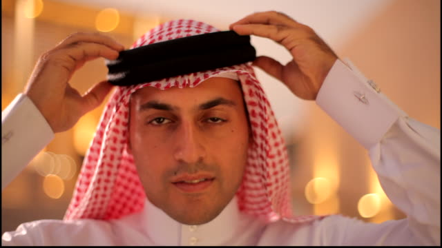 view of a bahraini man wearing their traditional agal and keffiyeh posing for the camera. - human face stock videos & royalty-free footage