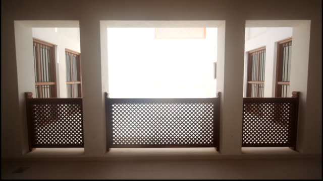 view of a balcony the al nuzul guest house part of the shaikh ebrahim center for culture and research showcasing traditional bahraini architecture - veranda stock videos & royalty-free footage