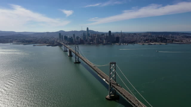 view of a big city and the bay bridge in san francisco, usa - san francisco oakland bay bridge stock videos and b-roll footage