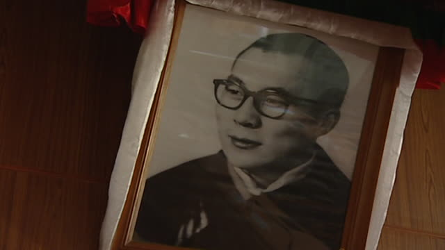 view of a black and white photograph of the 14th dalai lama, tenzin gyatso, as a young man. the residence of the 14th dalai lama in exile is in... - traditionally tibetan stock videos & royalty-free footage
