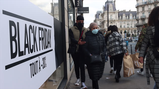 view of a black friday advertisement in a shop window with people walking past on december 04, 2020 in paris, france. following a meeting with the... - friday stock videos & royalty-free footage