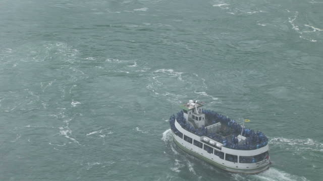 view of a boat cruising in niagara river new york united states - river niagara stock videos and b-roll footage