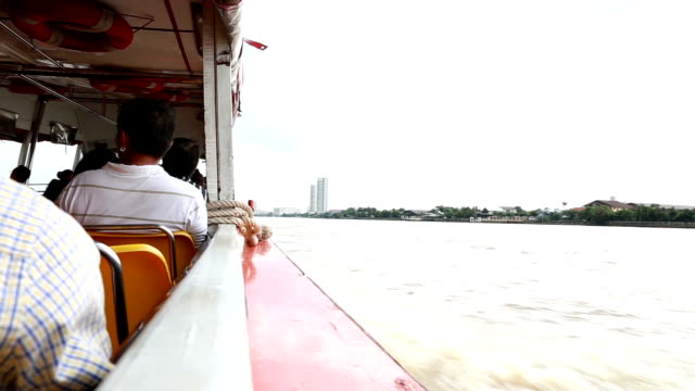 view of a boat sailing in the chao phraya river. - human pyramid stock videos and b-roll footage