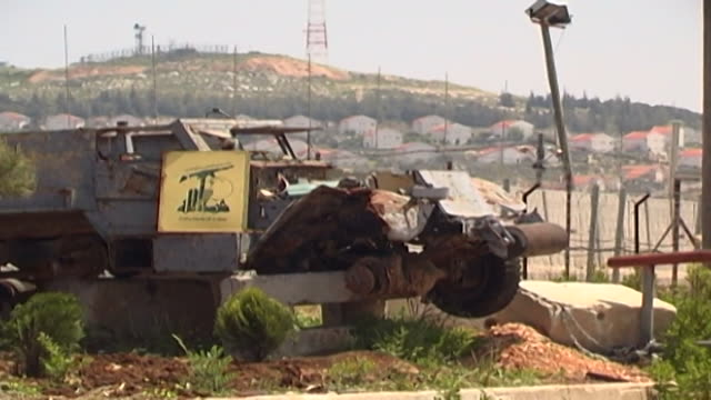 view of a burnt-out israeli armoured military vehicle on the lebanese side of the border with israel. the hezbollah placard means that it was... - israeli military stock videos & royalty-free footage