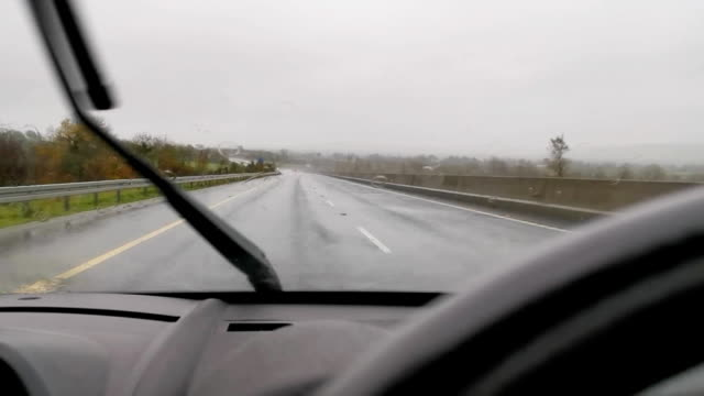 view of a car dashboard and a window during rain - windscreen stock videos & royalty-free footage