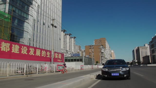 view of a car driving around beijing - 2017 stock-videos und b-roll-filmmaterial