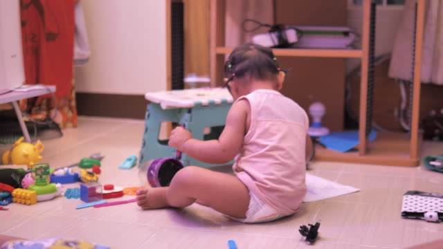 view of a child drawing with crayons on paper or doing homework from home - male with group of females stock videos & royalty-free footage